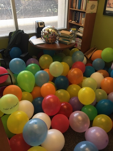 200 balloons in Levi's office.